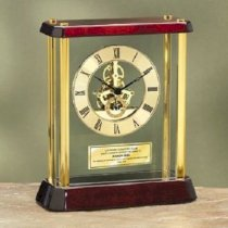 Premier Personalized Table Glossy Cherry Wood Desk Clock Enclosed in Glass Box and Brass Pillars with Da Vinci Dial and Gold Engraving Plate. This personalized clock is a nice anniversary gift, retirement gift and corporate employee recognition service aw